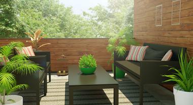 Área externa com sofá e poltronas