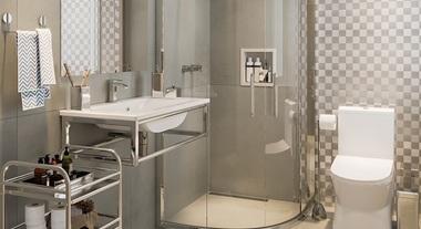 Banheiro grande com pastilha de metal