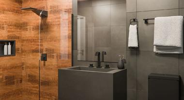 Banheiro pequeno com granito preto