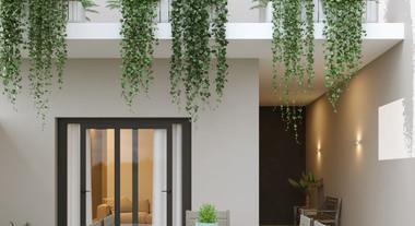 Fachada Externa de Casa Pequena com Mosaico no Chão e Móveis