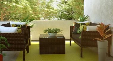 Sofás e almofadas trazem conforto ao jardim